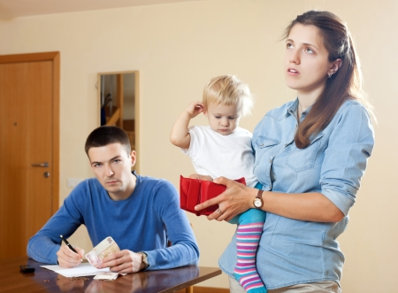 Financial problems in the family with baby photo