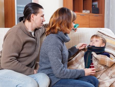 medicament: Parents giving  medicament to unwell teenager son