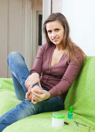 toenail fungus: beauty woman caring for  toenails on your feet at home Stock Photo