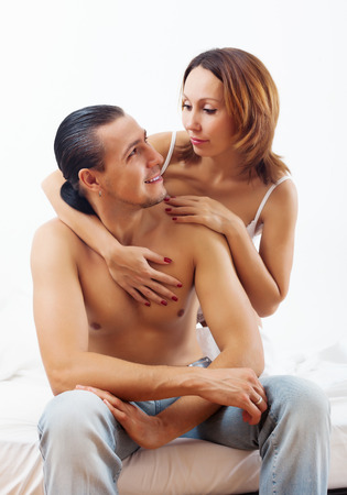 Woman consoling the  husband in bed Stock Photo - 24859842