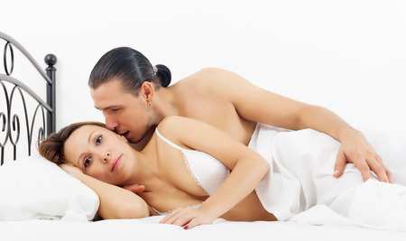 arouse: Middle-aged couple awaking in bed at home Stock Photo