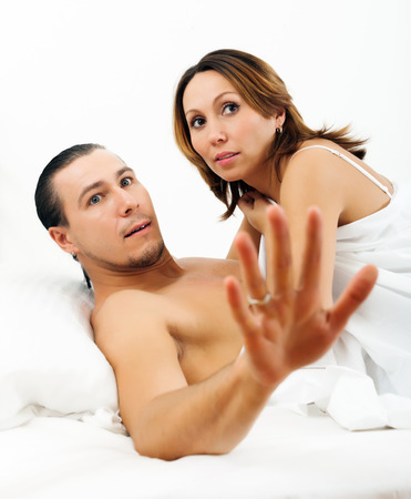 Frightened man and woman caught during sex together photo