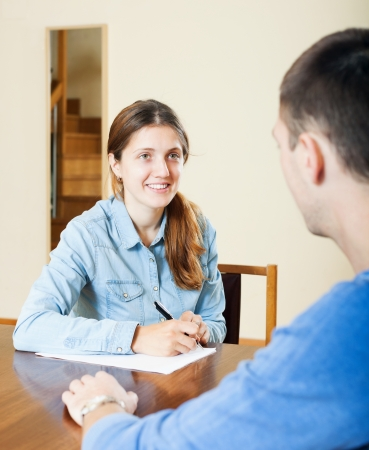 social worker: Handsome man an answer questions of social worker in home Stock Photo