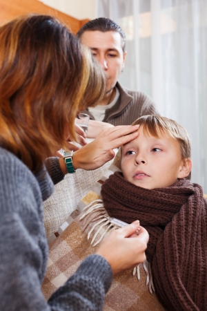 nosotrophy: Parents measuring the temperature of  unwell boy at home
