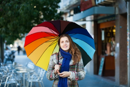 Girl in autumn jacket with umbrella  at street Stock Photo