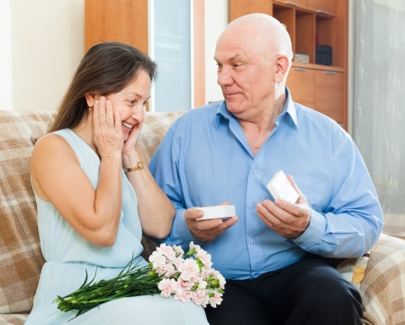 Man presenting woman the  jewel  box  at home    photo
