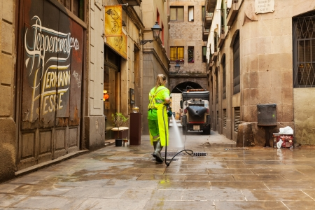 BARCELONA, SPAIN - JUNE 1  Wet cleaning of ancient streets in June 1, 2013 in Barcelona, Spain  Street sweeper cleaning  ancient district with water