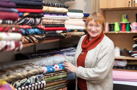 store keeper: Mature woman at fabric store