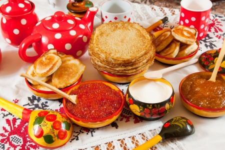 Pancake with red caviar and tea during  Pancake Week  photo