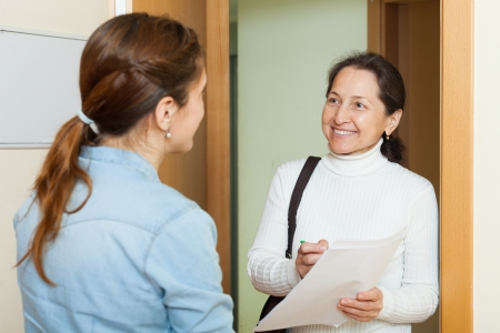 polling: Mature woman polling among the population at home  door