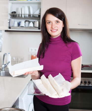 prepack: Smiling girl with store-bought dough at home Stock Photo
