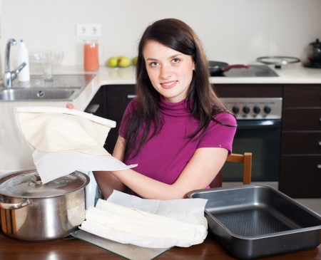 prepack: Girl cooking with prepared shop-bought dough at home kithen Stock Photo