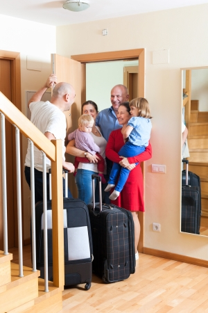 relatives: Happy family seeing off the relatives to home