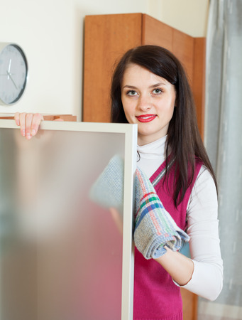 dusting: housewife dusting glass of furniture at home Stock Photo