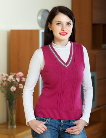 casualy: Portrait of smiling  woman in home or office interior