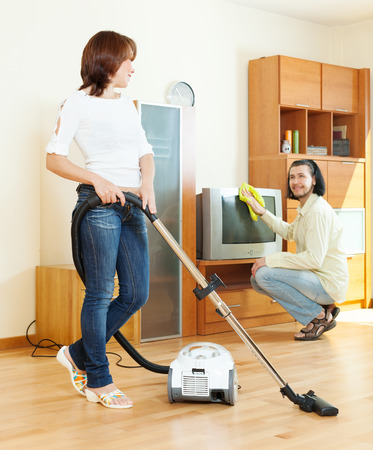 amicable couple doing housework together  photo