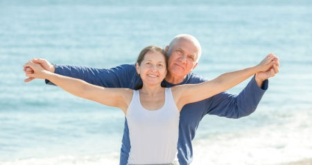 Portrait of mature couple at sea beach photo