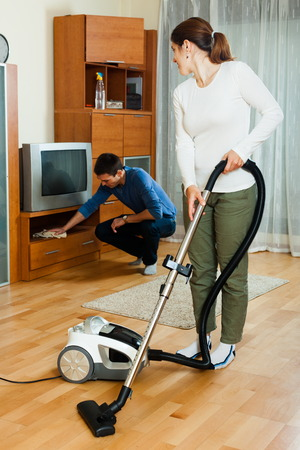 Adult couple doing housework together in home photo