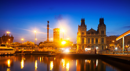 view of Columbus Quay from Port Vell in evening. Barcelona, Catalonia photo
