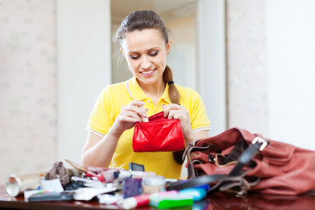 disarrangement:  inconsiderate woman lost something and found this thing in purse Stock Photo