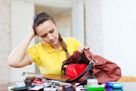 ransack: Inconsiderate woman lost something and looking in her purse