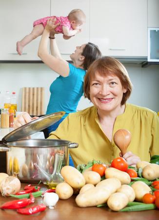 three generations of women: Women of three generations at domestic kitchen