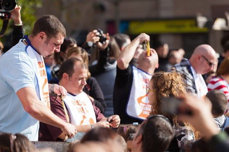 concurs: VALLS, CATALONIA - JANUARY 26, 2014  Competition for best eater of  calsot during Calcotada in Valls