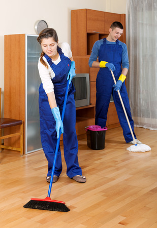 cleaning team: Man and woman cleaning in living room