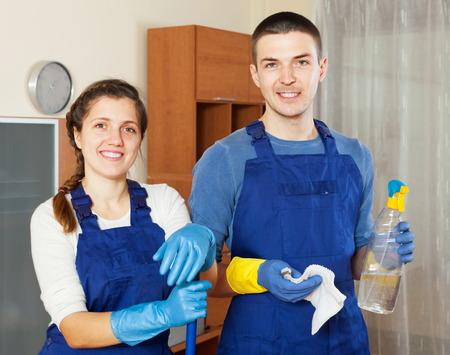 houseman: Smiling cleaners team cleaning floor in room