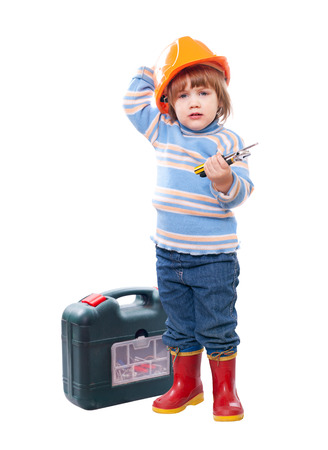 child in hardhat with tools and tool box. Isolated over white photo
