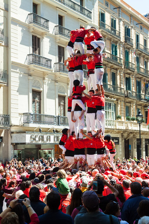 BARCELONA, SPAIN - APRIL 14: Traditionally Catalan show in April 14, 2013 in Barcelona, Spain. Castellers de Barcelona performing at avinguda Portal del Angel