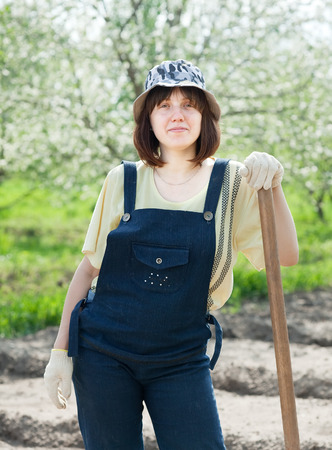 female farmer with spade in spring photo