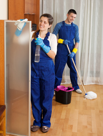 company premises: Professional cleaners cleaning in room at home