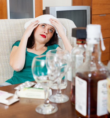 cephalgia: girl having headache in morning after party