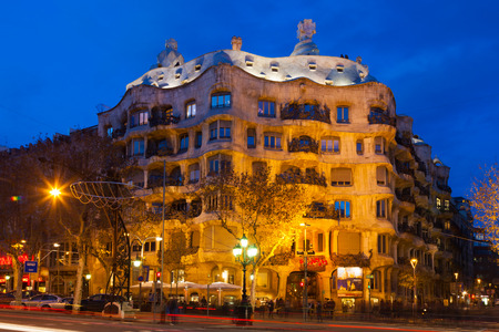 paseig: BARCELONA, CATALONIA - JANUARY 2, 2014: Night view of Casa Mila  in Barcelona, Catalonia.  House was built in 1905–1910 by Catalan architect Antoni Gaudi   Editorial