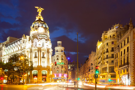 MADRID, SPAIN - AUGUST 29: City streets in evening time on August 29, 2013 in Madrid, Spain.  The Crossing  Calle de Alcala and Gran Via -  most important avenues of city