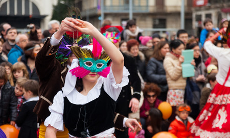 mummery: BARCELONA, SPAIN - MARCH 2, 2014: Dancing people at Carnival Balls at Placa Comercial in Barcelona  Editorial