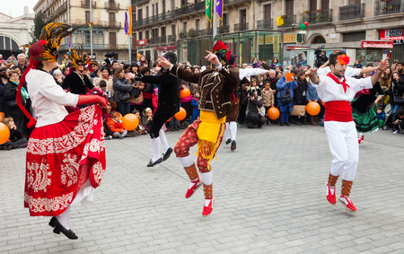 mummery:  BARCELONA, CATALONIA - MARCH 2, 2014: Dancing people at Carnival Balls at Placa Comercial in Barcelona