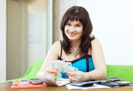 Woman is calculated the family budget at  home photo