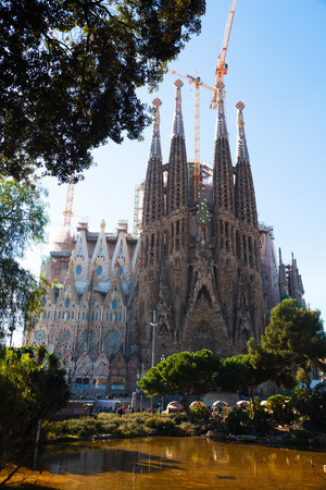 uncomplete: BARCELONA, SPAIN - DECEMBER 22, 2013: Sagrada Familia in Barcelona.  Famous Church by Catalan architect Gaudi, building is begun in 1882 and completion is planned in 2030