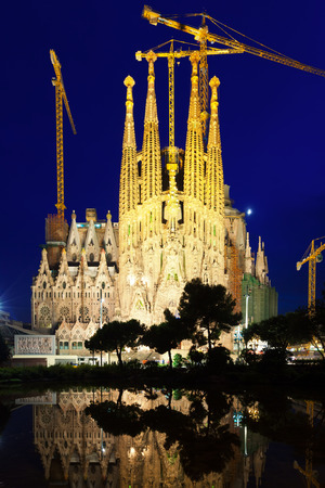 uncomplete: BARCELONA, SPAIN - JULY 14: Sagrada Familia in night in July 14, 2013 in Barcelona, Spain.  Famous Church by Catalan architect Gaudi, building is begun in 1882 and completion is planned in 2030 Editorial