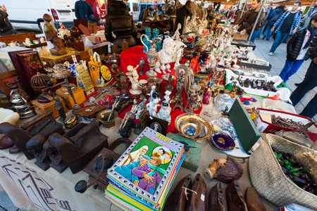 jumble: BARCELONA, SPAIN - FEBRUARY 20, 2014: Old things at flea market at square before Catedral de Barcelona