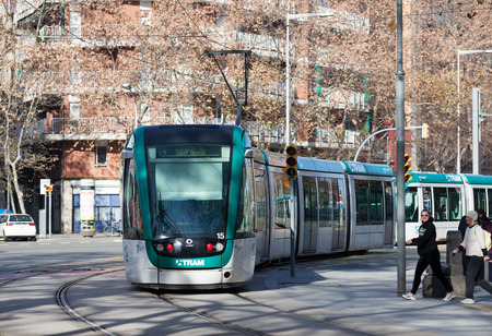 tramcar: BARCELONA, SPAIN - JANUARY 1, 2014: Tram on street at Barcelona in winter