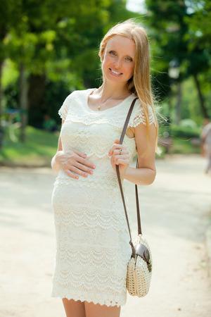 gravida: Image of  pregnant woman in city park  Stock Photo