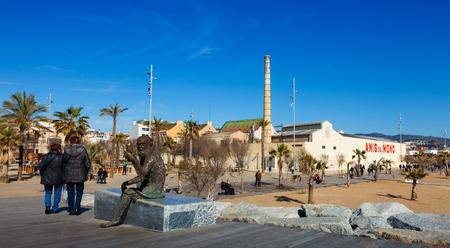 fabrica: BADALONA, SPAIN - MARCH 2, 2014: Fabrica and statue of Anis del Mono - registered trademark of anise popular Spanish origin (Badalona) brand