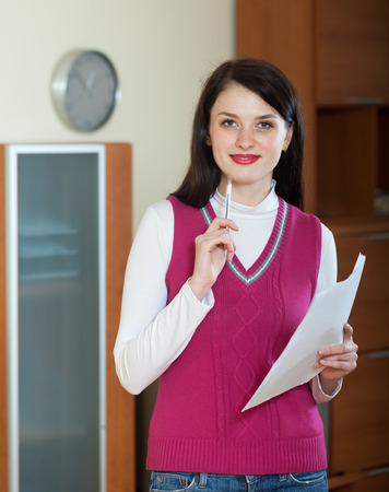 home office interior: woman with  documents at home or office interior