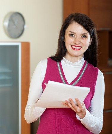 home office interior: Portrait of  woman with  documents in home or office interior