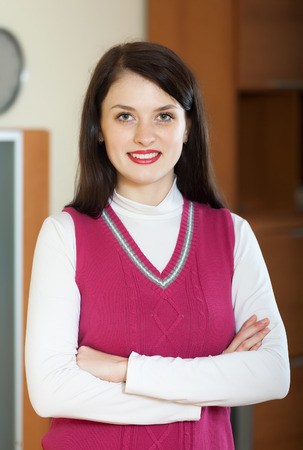 casualy: happy frendly woman in home or office interior