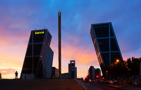 MADRID, SPAIN - AUGUST 28: Plaza de Castilla in dusk on August 28, 2013 in Madrid, Spain. Monument to Calvo Sotelo, Caja Madrid Obelisk and KIO towers