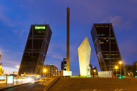 MADRID, SPAIN - AUGUST 28: Gate of Europe in night on August 28, 2013 in Madrid, Spain. Monument to Calvo Sotelo, Caja Madrid Obelisk and KIO towers